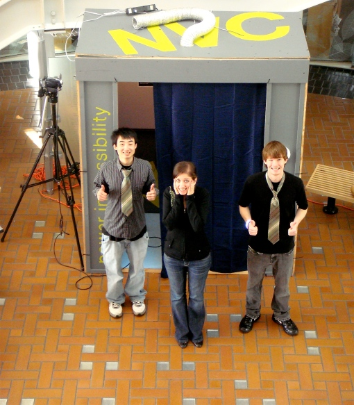 "Members of Allen Hall Advertising take a moment to pose in front of the ""elevator."""