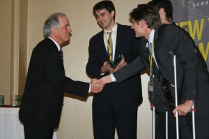 University of California, Berkeley's Integrated Diagnostics is rewarded with a $5,000 third place prize from University of Oregon's Dean of the Charles H. Lundquist College of Business, Dennis Howard.