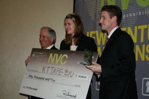 Brigham Young University's KT Tape accepts the $50,000 first place check from University of Oregon's Dean of the Charles H. Lundquist College of Business Dennis Howard